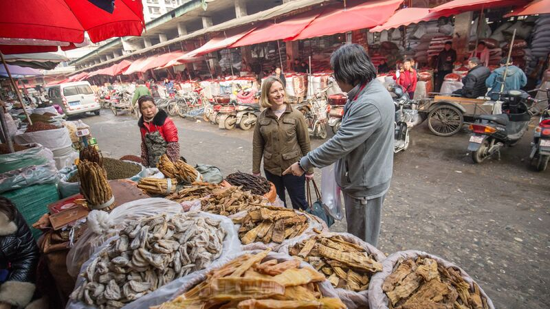 A man points out street food in Chengdu