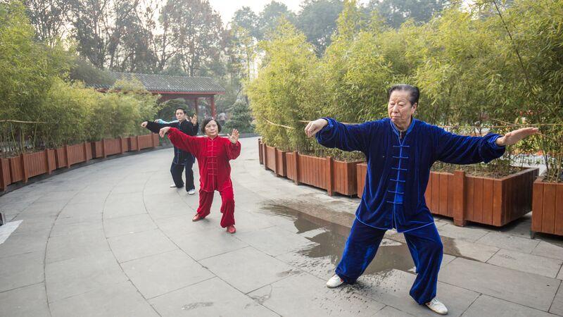 Three people practicing Tai Chi in China