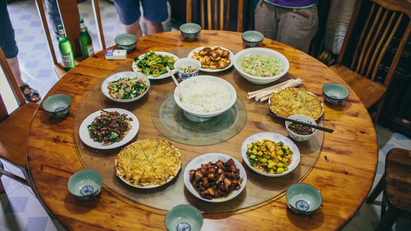 A table covered in plates of food in China