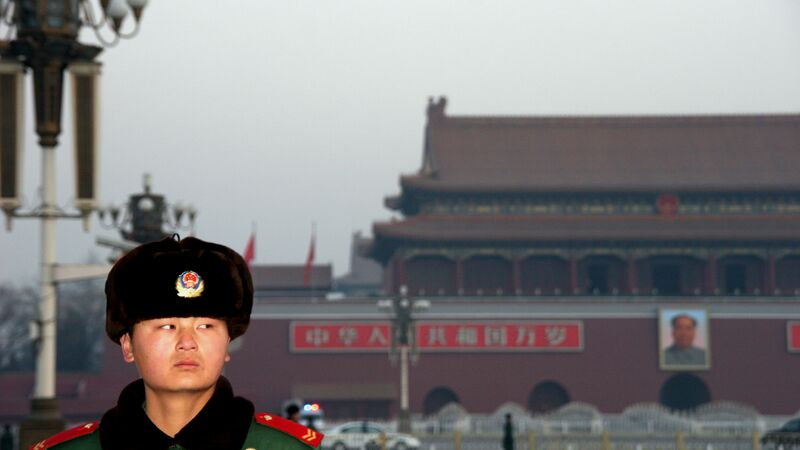 A guard in China giving the camera a sideways glance