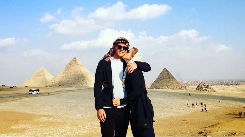 Two people kissing at the pyramids