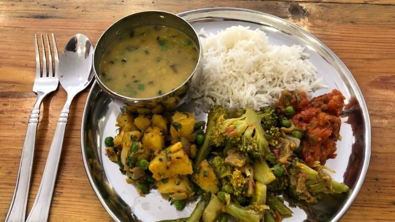 A plate of dal bhat, rice and broccoli in Nepal