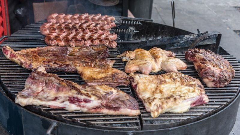 A barbecue covered in meat in Argentina
