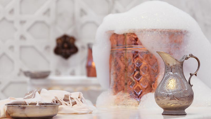 Bubbles and water jugs at a Turkish Hamam.