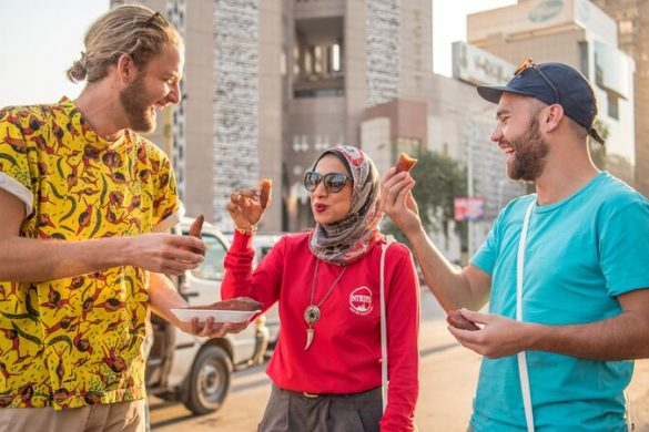 Two yound travellers with their local leader in Egypt