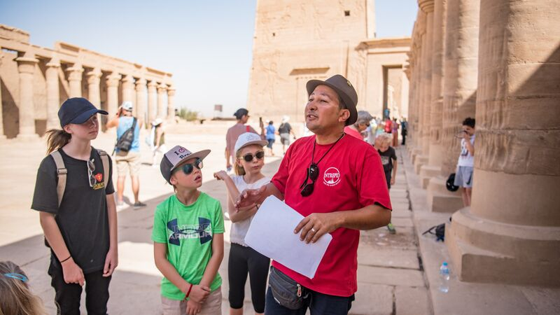 An Intrepid leader with a family group in Egypt