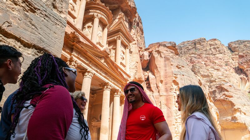 Travellers with their leader in Petra