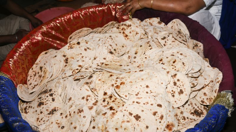 A huge bucket of flat bread, made at a Sikh temple in India