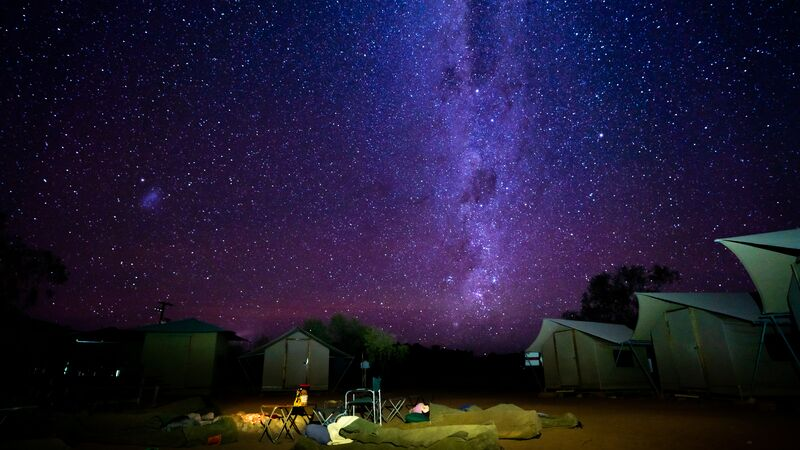 Two campers sleeping under the stars in outback Australia
