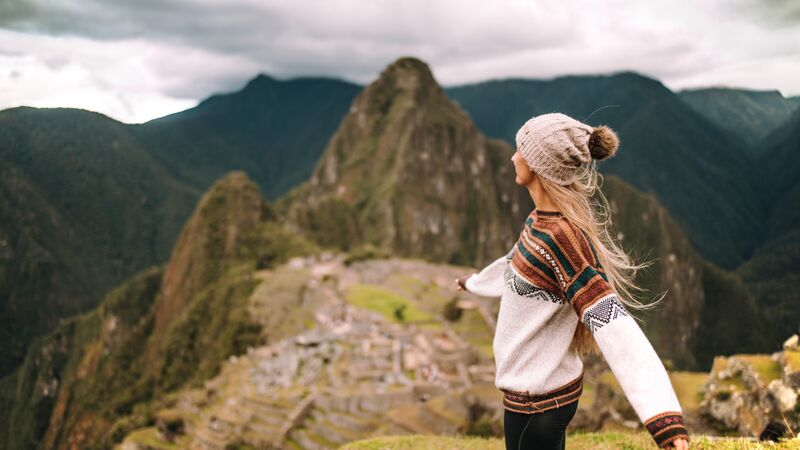 A girl dancing at Machu Picchu