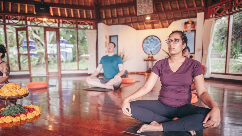 People in a yoga class in Bali