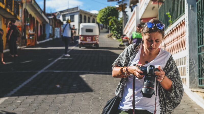 A woman checking her camera settings in Guatemala.