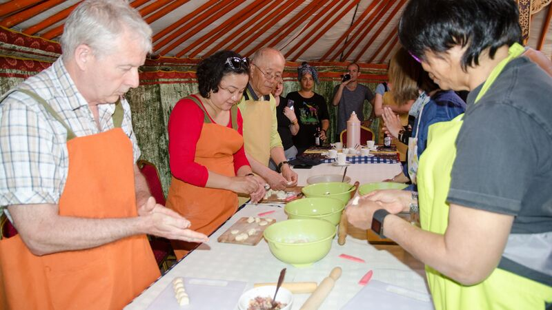 Travellers at a cooking class in Mongolia