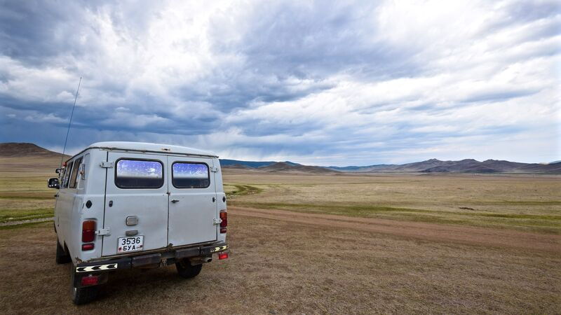 A Russian van driving through Mongolia