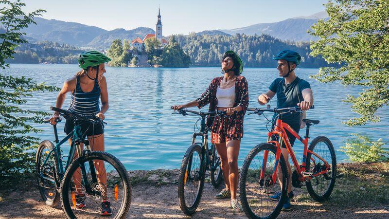 Three cyclists at Lake Bled, Slovenia