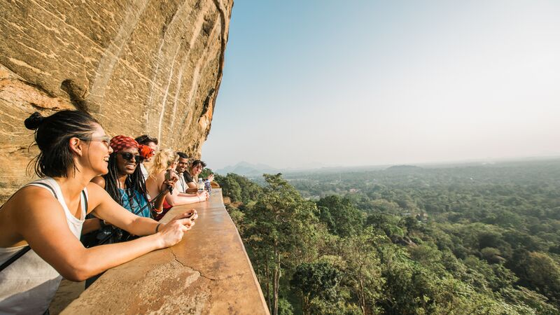 Travellers looking at a beautiful view from a cliff in Sri Lanka