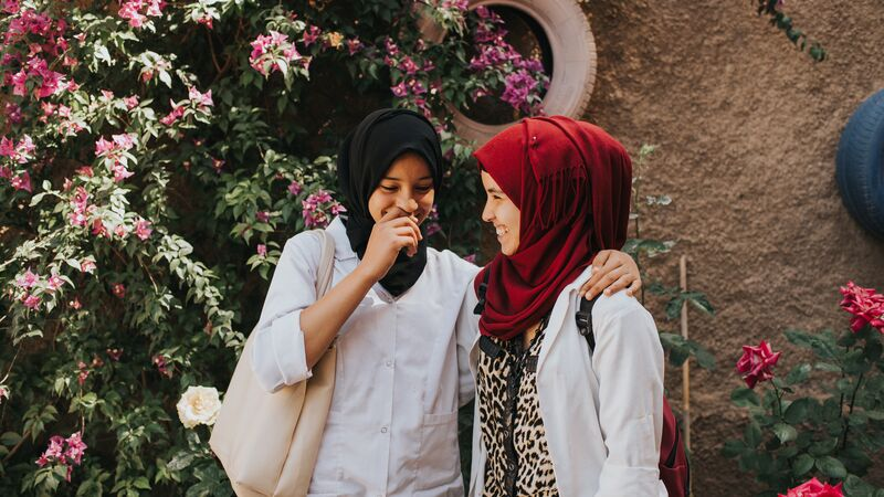 Two Moroccan girls laughing