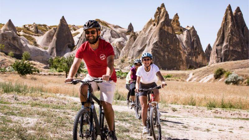 People cycling through Cappadocia in Turkey