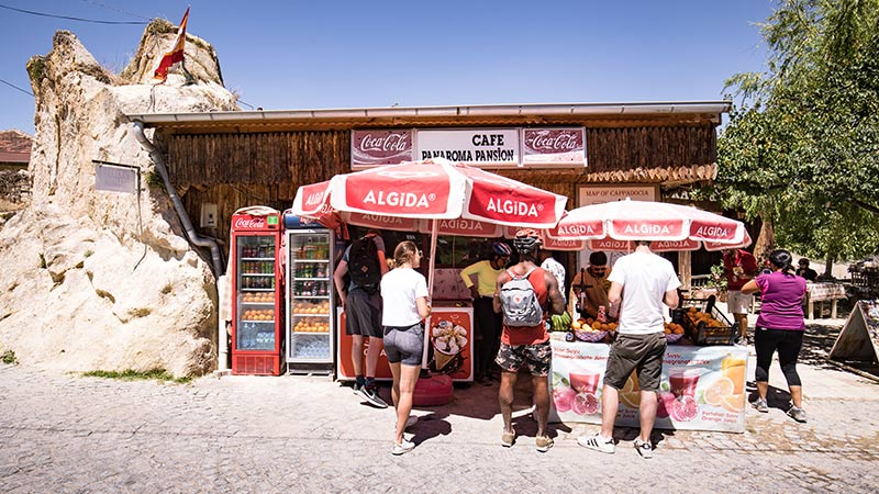 Travellers stocking up on cool drinks at a small shop in Turkey