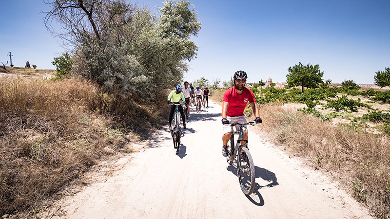 A group of cyclists on a dirt road in Turkey