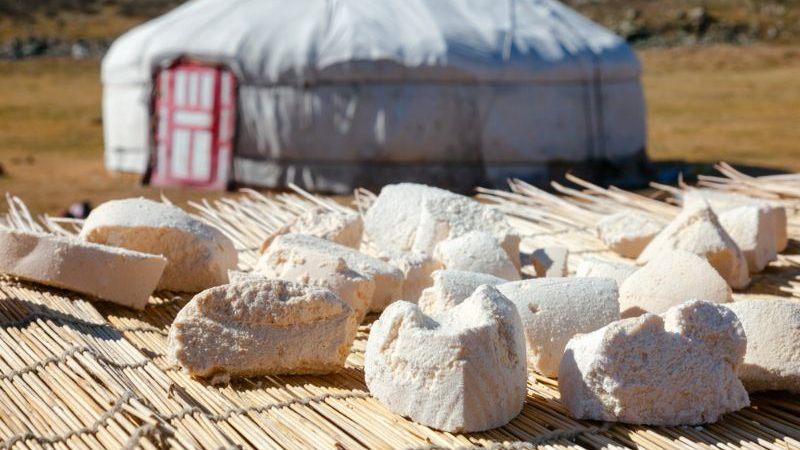 Dried cheese on a table outside a tent in Mongolia