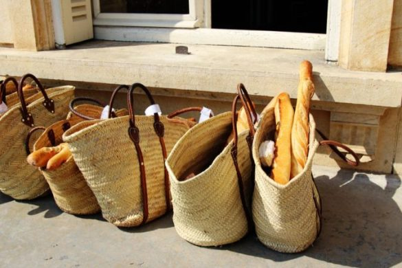 Wicker bags filled with French baguettes in Paris