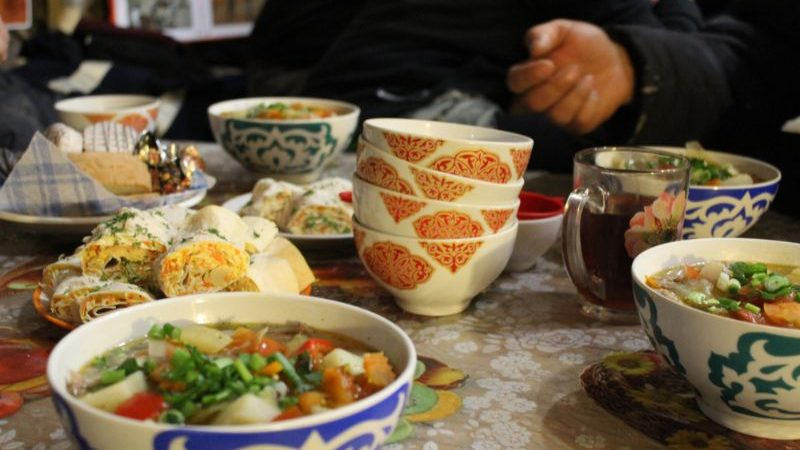 A table covered in bowls of Mongolian food