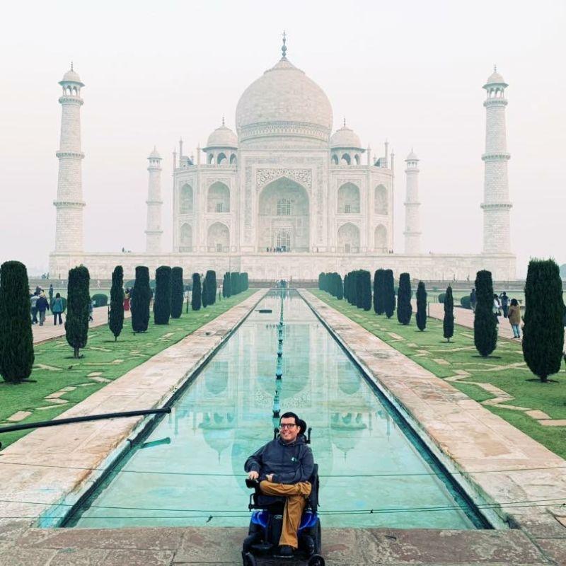A man in a wheelchair at the Taj Mahal