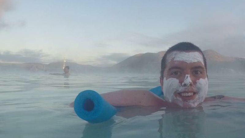 a man floating in the Blue Lagoon in Iceland