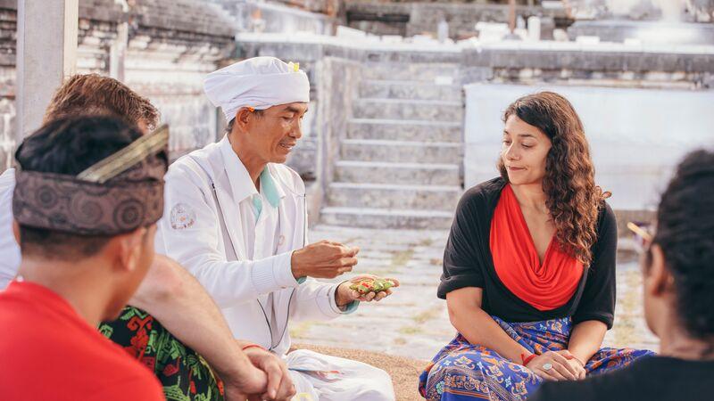 Rosa meets a holy man at Lempuyang Temple in Bali.