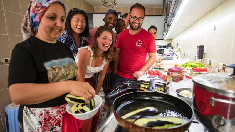 A group of travellers at a cooking class in Turkey