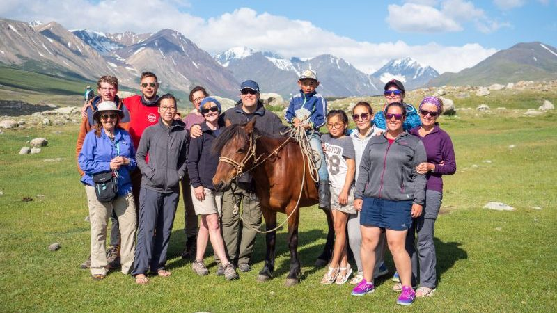 A group of travellers with a Mongolian family and a horse