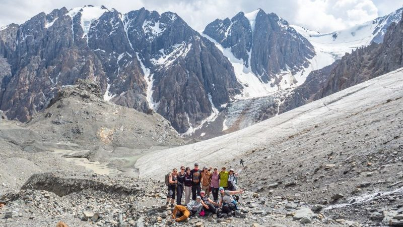 A group of trekkers hiking to a glacier in Russia