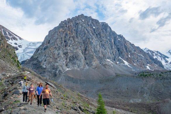 Trekkers walking to a glacier in Russia