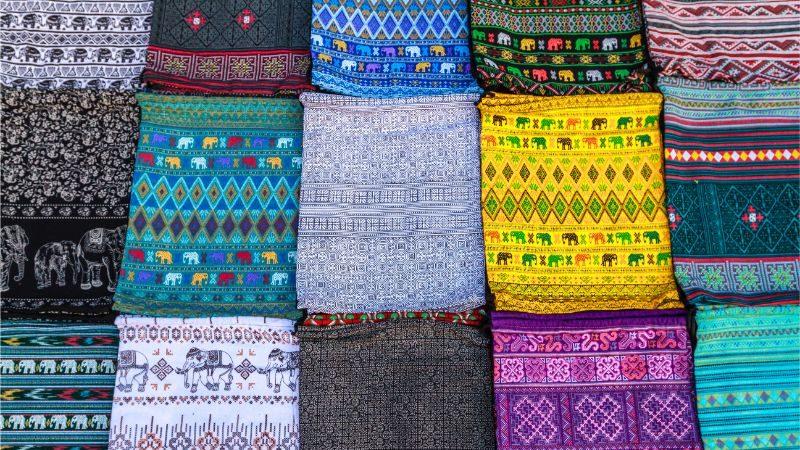 Colour fabrics at a market in Laos.