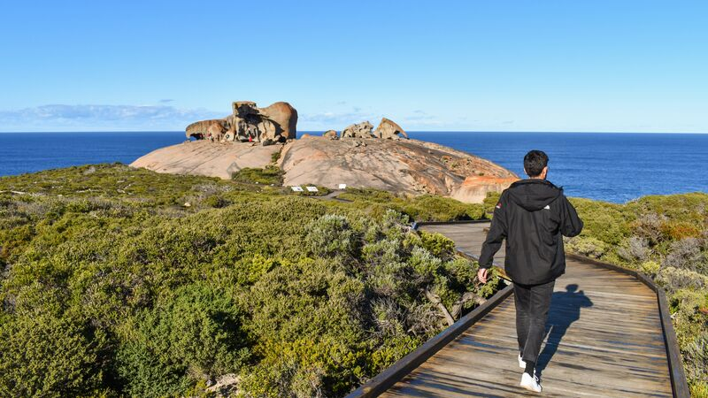 Person walking towaerds the remarkable rocks on Kangaroo Island