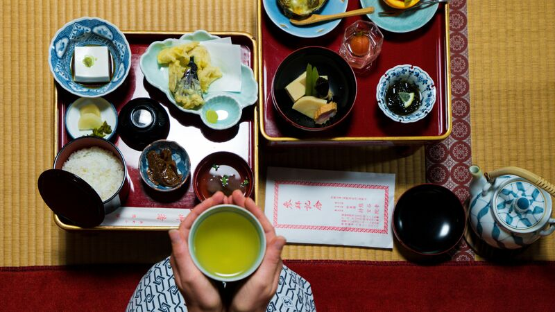 Two trays filled with a traditional Japanese breakfast