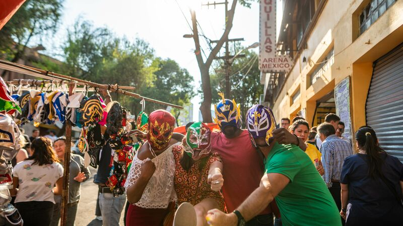 Four travellers wearing wrestling masks
