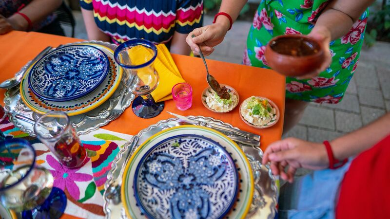 Brightly coloured plates of Mexican food