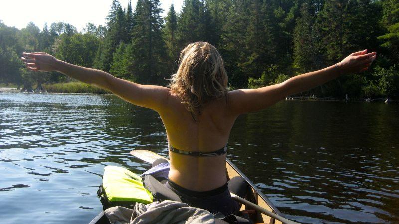 A woman in a canoe in Canada.