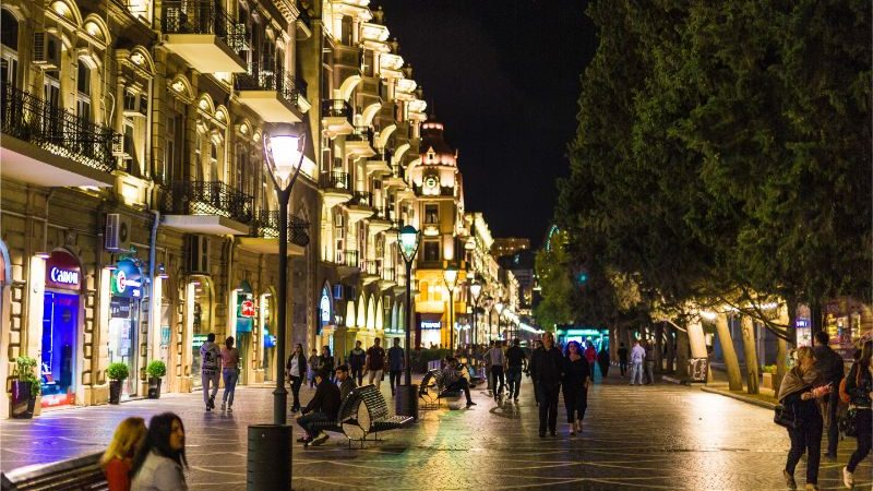 A street lit up with lights in Baku