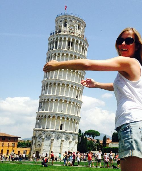 "Woman ""hugging"" the leaning tower of Pisa."