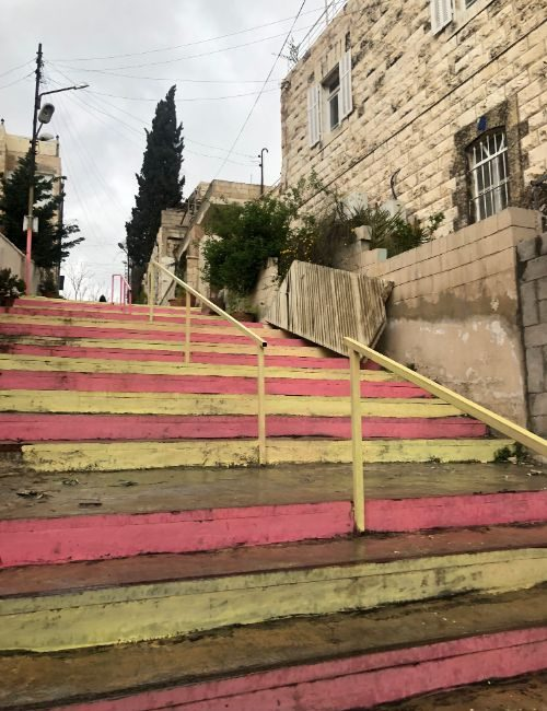 Pink and yellow stairs in Amman