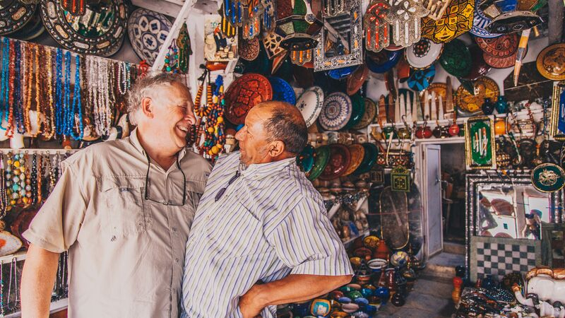Two men in a shop in Morocco.