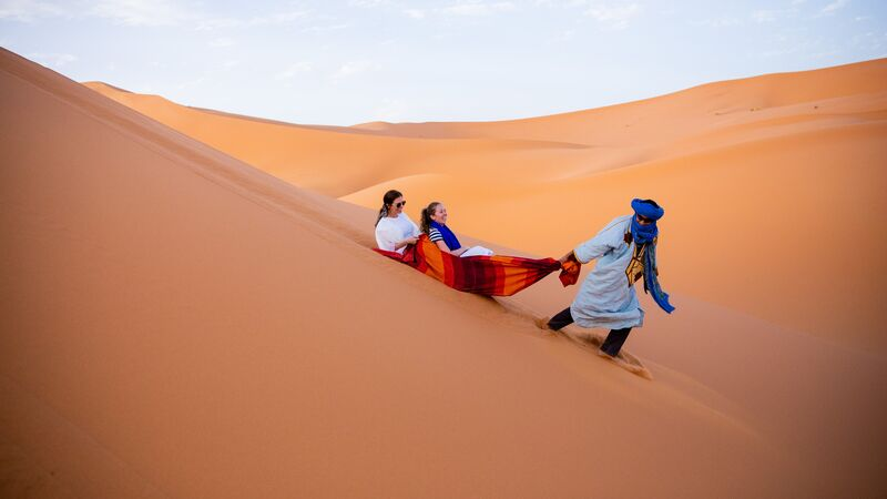 Two travellers and a Berber in Morocco