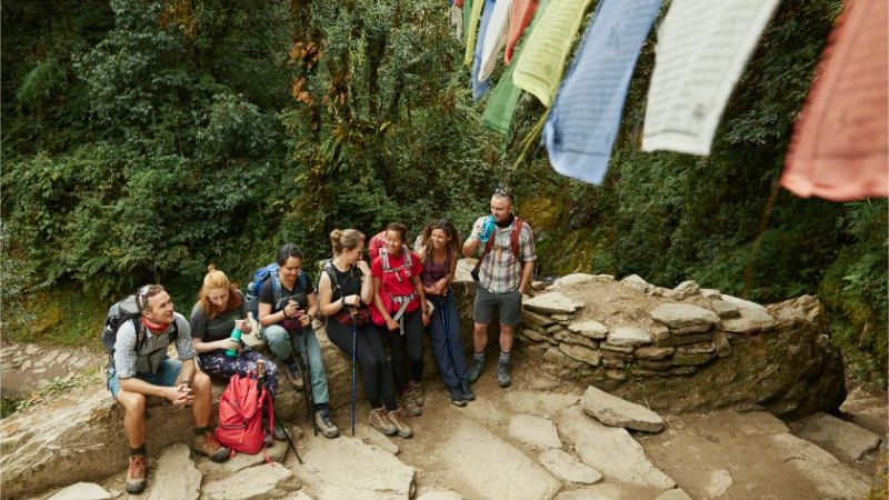 A group of trekkers stop for a drink on the Annapurna Base Camp trail