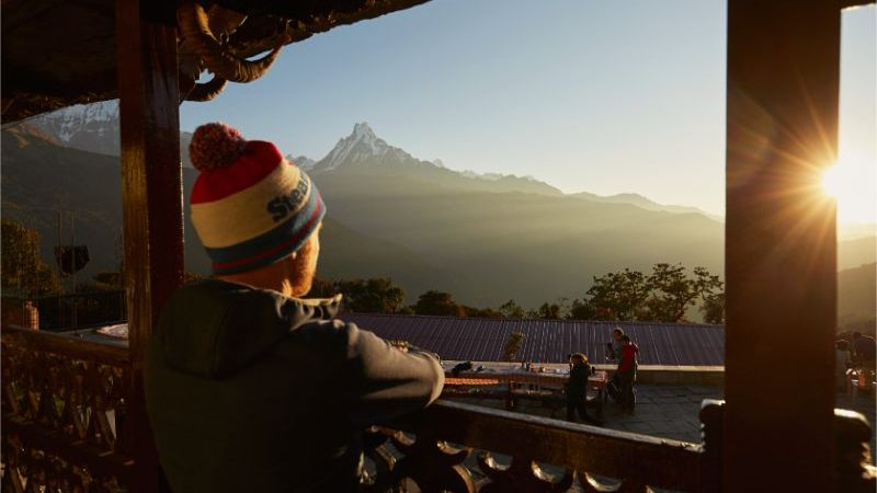 A man gazes at a mountain in Nepal