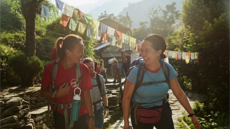 A hiker and her trekking guide in Nepal