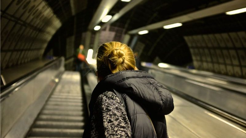 A woman on an escalator in London
