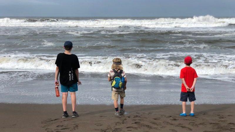 Three boys on a beach in Costa Rica